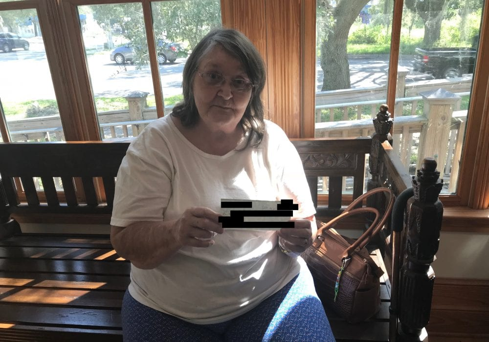 Gainesville Woman Receives Settlement Check